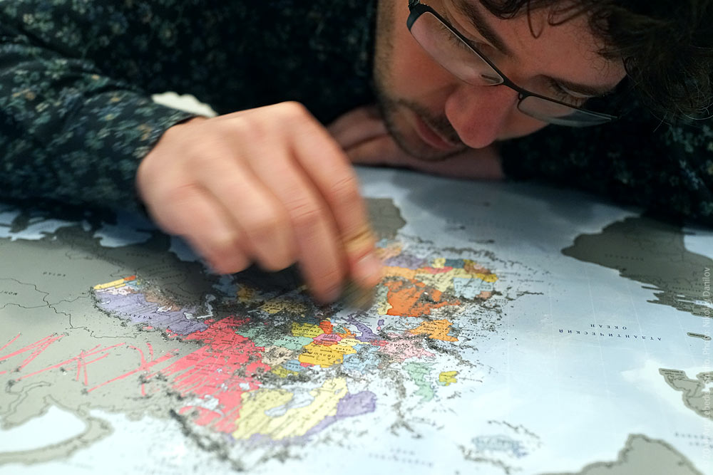 Artemy lebedev in photos of the day artmey lebedev scratching the i was here scratch off world map gumiabroncs Images